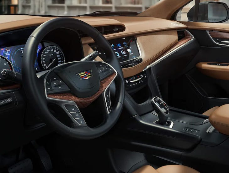 An inside look at a Cadillac dashboard.