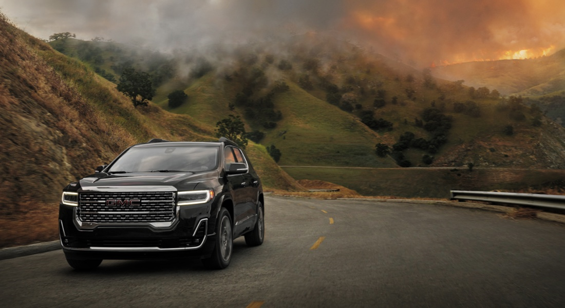 GMC SUV driving away from wildfires