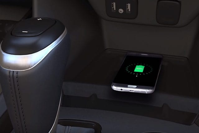 Phone resting on vehicle's wireless charging pad