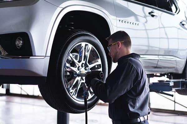 A service technician installing a tire